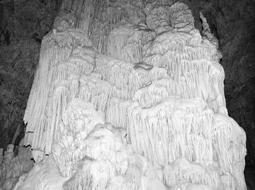 Limestone, rich in calcite, is susceptible to dissolution -- a form of chemical weathering.