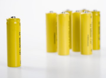 You must connect batteries to a circuit to measure their power output.