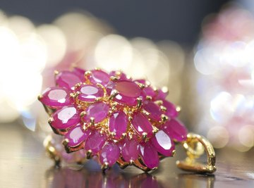 Gold pendant filled with rubies.