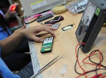 Students working on an electronics project at a table.
