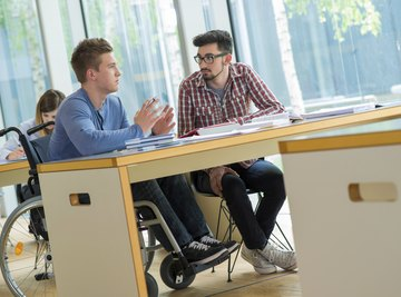 Student in wheelchair sitting at desk