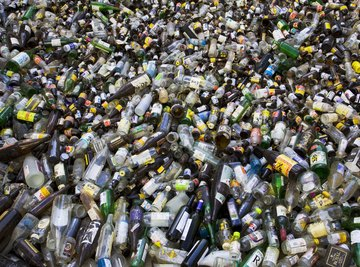 A large pile of plastic bottles at a recycling facility.