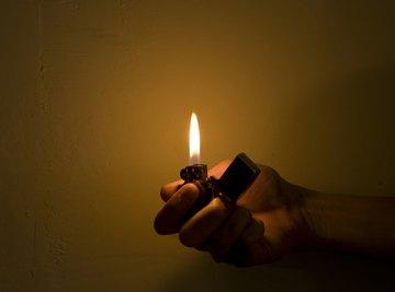 A lighter flame experiment produces vivid colors.