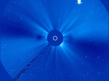 The coma and tail of a comet are visible when the comet approaches the sun.