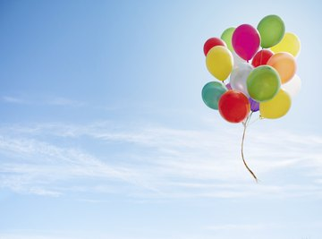 Colorful bunch of balloons in the sky.