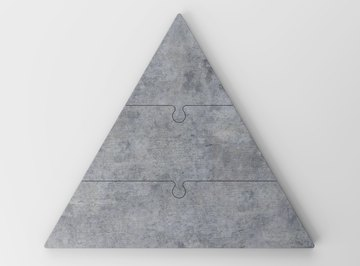 A pyramid made out of three puzzle pieces