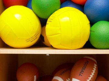 Volleyballs are spherical; footballs are not.