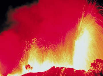 Volcanoes create land mass and form fertile soil as the volcanic materials wear down.