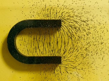 Iron filings show the magnetic field surrounding a magnet.