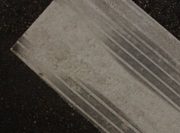 Skid marks are measured to determine rate of speed.