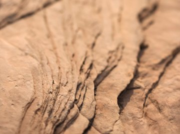 Divergent plate boundaries build new rock by letting magma bubble through the crust.