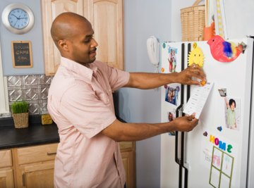 Magnets are attracted to paramagnetic or ferromagnetic materials like those in a refrigerator door.