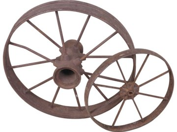 A larger wheel travels farther at a set angular speed.