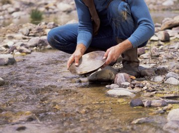 Mining of alluvial gold deposits is a traditional gold extraction method still used today.
