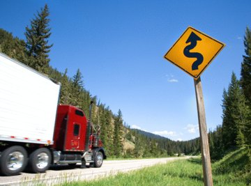 Truckers must switch to low gears when going down steep hills.