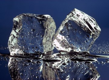 Ice melts as heat energy overcomes forces between molecules.
