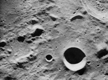 The surface of Mercury is scarred with craters.