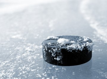 When a hockey puck slides across the ice, it does so at a fairly constant speed until it hits the goal or a player's stick. Although it's moving, it's not accelerating.