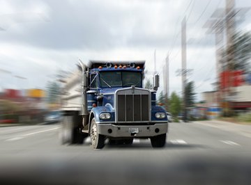 Hydraulic systems are used to empty dump trucks.