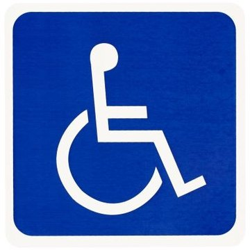 The International Standard Handicap symbol is painted on handicap parking spaces.