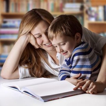 Children learn language by imitating what they hear from those around them.