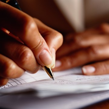 Woman Writing In Checkbook Close Up