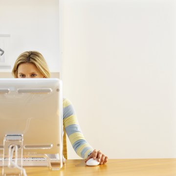 Front view of young woman working on computer