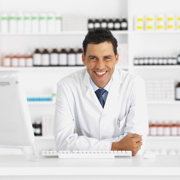 pharmacist standing at counter