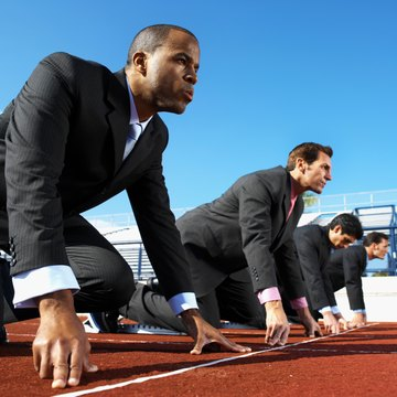 businessmen on start line of running track, low angle view, side view