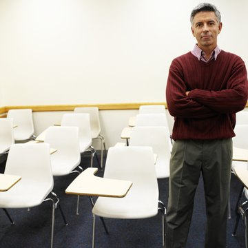 portrait of an elderly man standing in a classroom