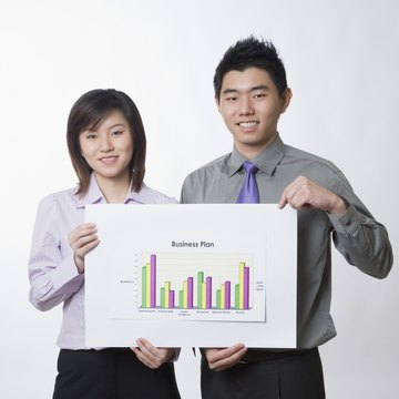 Coworkers holding business plan