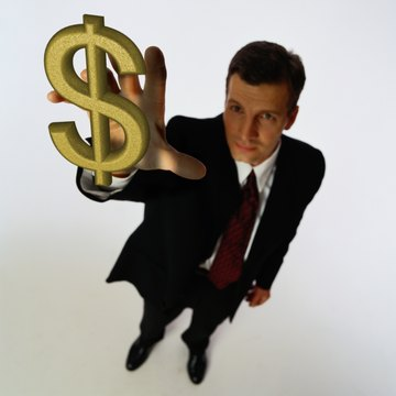 Businessman Holding a Dollar Sign