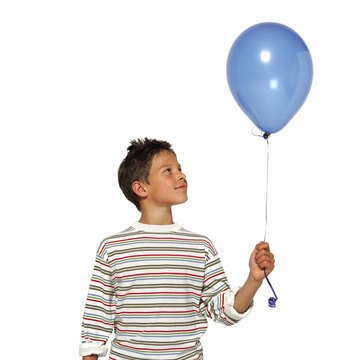 Centripetal force will keep a penny spinning inside a balloon.