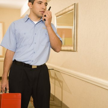 Hotel repairman on phone