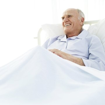 portrait of an elderly man in a hospital bed
