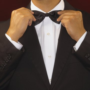 Standard black-tie attire means tuxedos for men and evening gowns for women.