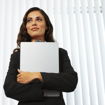 low angle view of a woman standing and holding a clipboard