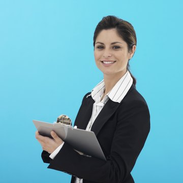 Business woman with clipboard, portrait