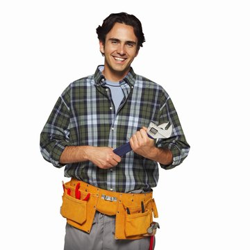 portrait of a man wearing a tool belt