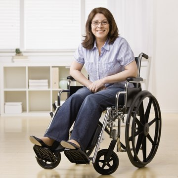 Confident smiling disabled woman sitting in Wheelchair