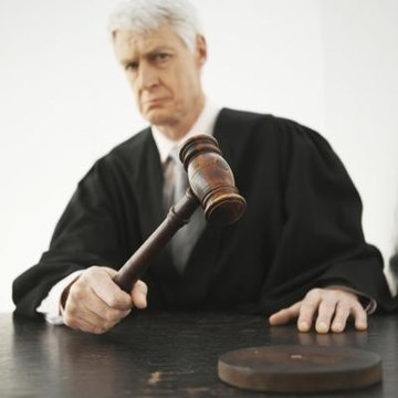 A judge makes the final determination regarding the disposition of a warrant.