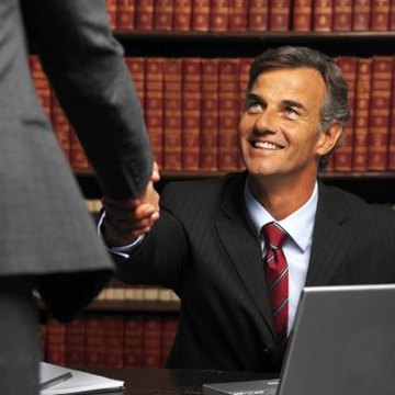 Attorney shaking hand of client.