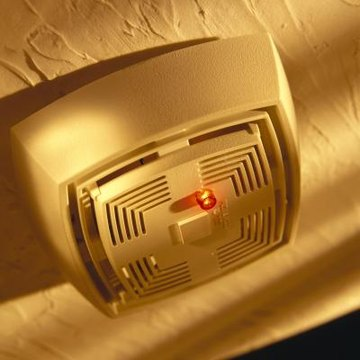 A small hole may be drilled in a smoke detector for a microphone.