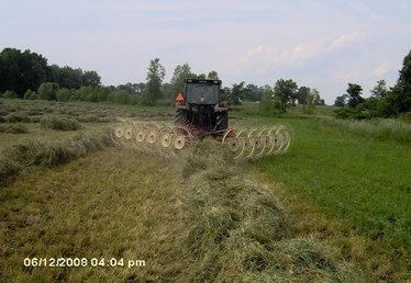 How to Round Rake a Hay Field