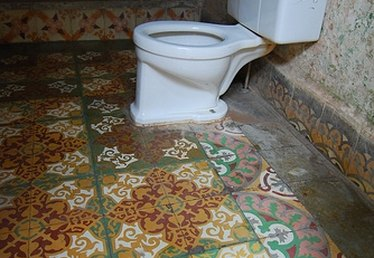 How to Install Ceramic Tile Around or Under the Toilet