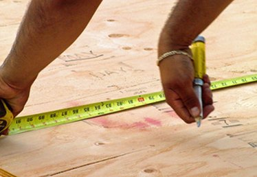 How to Lay a Plywood Subfloor on Cement