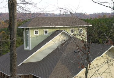 How to Remove Black Stains from Roof Shingles