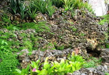 How to Landscape a Slope With Rocks