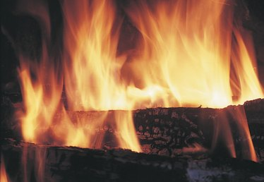 How to Burn Unseasoned Wood in a Fireplace