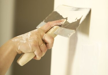How to Get Rid of Plaster Bumps in a Wall